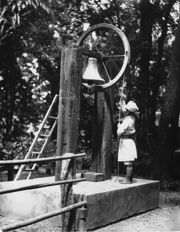 Ringing the work bell, India circa 1910